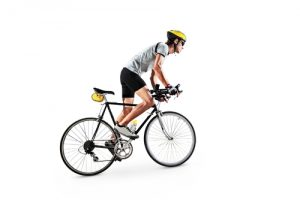 Male bicyclist pedalling.